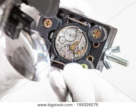 Watchmaker In Head-mounted Magnifier Repairs Watch