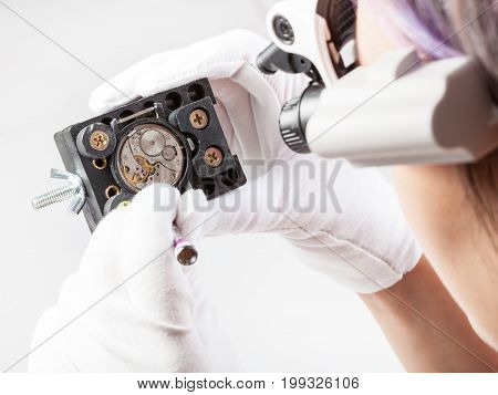 Watchmaker In Lenses Repairs Old Wristwatch
