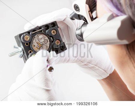 Watchmaker In Lenses Repairs Old Wristwatch