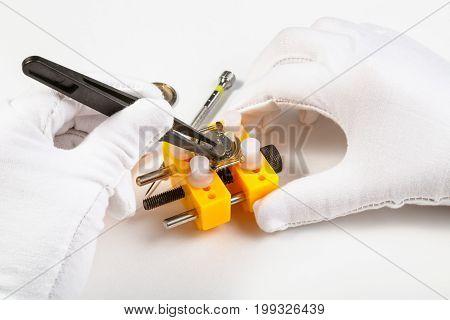 Replacing Battery In Quartz Wristwatch By Tweezers