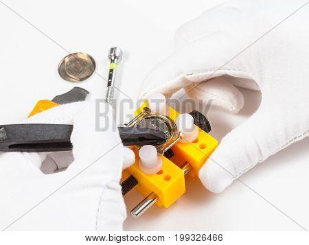 Fixing Of Battery In Quartz Watch By Tweezers