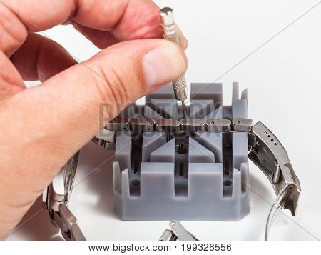 Adjusting Of Watchband With Punch Pin