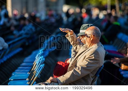 TALLINN, ESTONIA - 04 JUL 2014: People sitting and watching song concert at Tallinn Song Festival Grounds