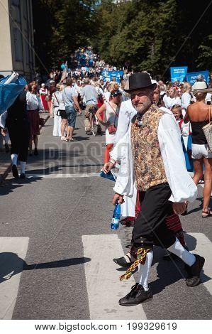 TALLINN, ESTONIA - 04 JUL 2014: People in national Estonian costumes preparing to ceremonial procession of Estonian song and dance festival