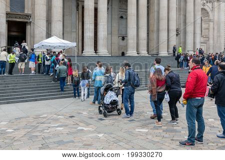 LONDON ENGLAND - JUNE 08 2017: Visitors in waiting queue for entrance St Paul Cathedral London England
