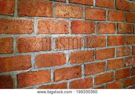 Terracotta brick wall in diminishing perspective view, for background and texture