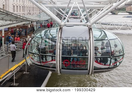 LONDON ENGLAND - JUNE 08 2017: Tourists entering a cabin of London Eye in London England