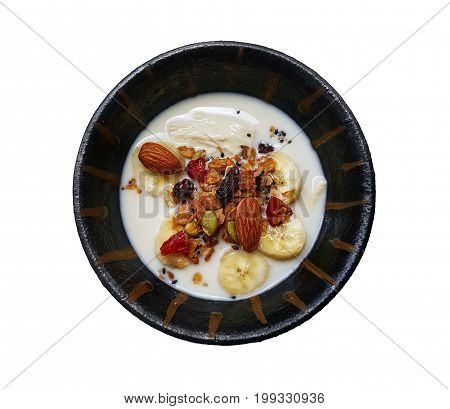 baked granola and berries with Soybean milk and banana in small bowl over white background strawberries blueberries Top view of Granola healthy food concept include clipping path
