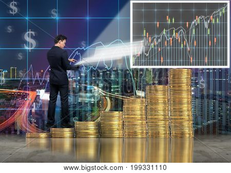 Asian Businessman standing over the stack of gold coins and using the tablet present the trading graph of Stock exchange market on trade graph background Business trading and education concept,3D illustration