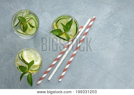 Refreshing Summer Drink With Lemon, Cucumber And Mint On Gray Background.