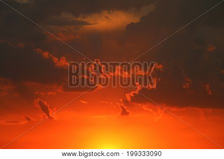 Thunderclouds at sunset. Gloomy dark gray clouds. Nature summer sunlight wallpaper