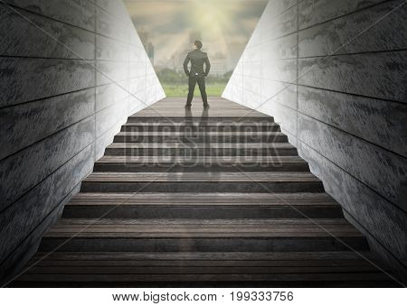 Businessman climbed on top of the stairs which can see abstract Blurred photo of city background Success business and Ambitions concept