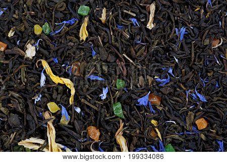 A large sheet of green tea, cornflower petals, sunflower petals, colorful candied fruit.