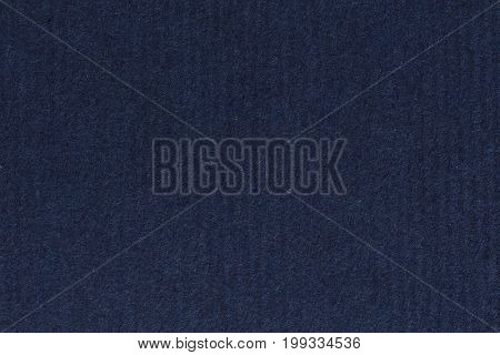 Photograph of dark, deep navy blue recycle striped paper, extra coarse grain, grunge texture sample. High resolution photo.