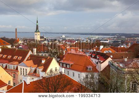View from Tallinn Toompea hill to downtown with St. Olafs church, towers and red roofs of the historical city center