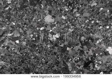 Abstract background of black granite texture. High resolution photo.