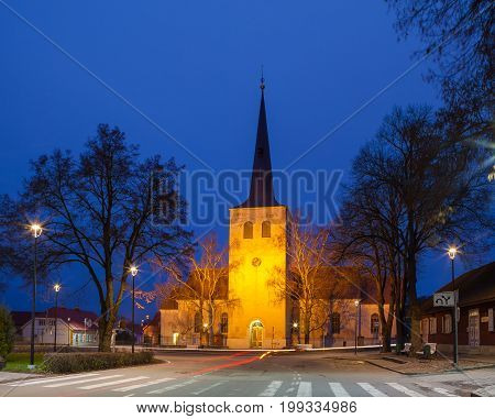 Night illuminated Lutheran church in Paide, Estonia. Classic Baltic Kirche