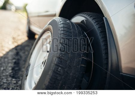 Broken car concept, spare wheel replacement