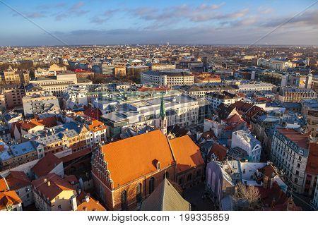 RIGA, LATVIA - 25 DEC 2016. Aerial view of old and new town. St. John's Church in Riga. Latvia