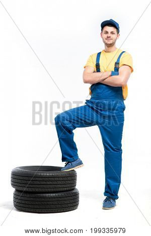 Tire serviceman isolated on white background