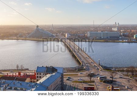 RIGA, LATVIA - 25 DEC 2016. Bridge over Daugava river and a new modern building of the national library is one of the most-discussed architectural objects in Riga, Latvia