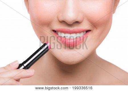 Pretty Face Beauty Lady Applying Lipstick. Beautiful Girl Makes Makeup