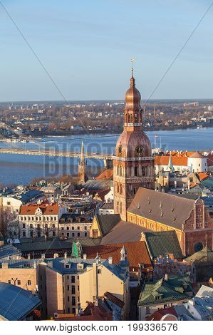 Riga Cathedral and Daugava river, aerial summer day view of old town from St Peter church, Latvia. Vertical shot
