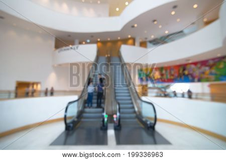 Abstract blurred photo of escalator with bokeh background