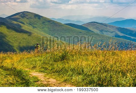 Tourist Stand In A Grass Observing Mountain Ridge