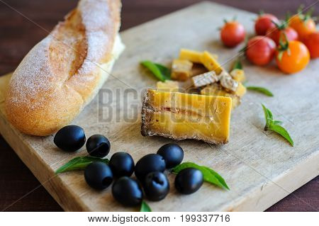 Piece Of Blue Cheese, Olives, And Tomatoes Close Up