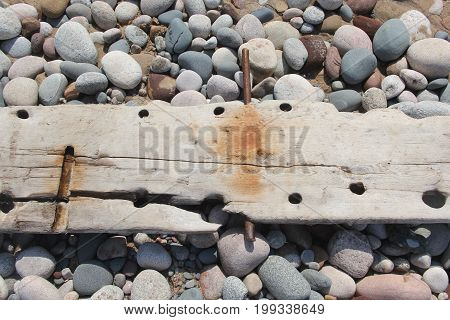 Wood plank of a ship wreck ship on a beach in Pictured Rocks National Lakeshore, Upper Peninsula of Michigan