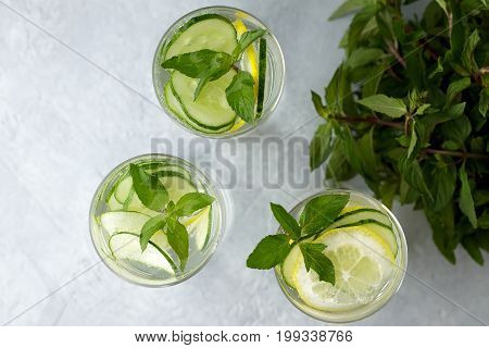 Refreshing Summer Drink-antioxidant With Lemon, Mint And Cucumber On Grey Background.