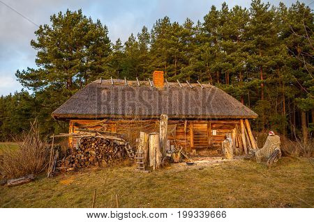 View of the rustic farm fisher's dwelling. Wooden architecture of North and Baltics
