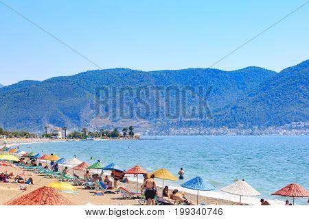 At Calis beach Fethiye Turkey- August 1 2017: People at the Calis beach near center of Fethiye city in Mugla Turkey