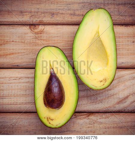 Food Background With Fresh Organic Avocado . Fresh Cutting Avocado On Wooden Background. Organic Avo