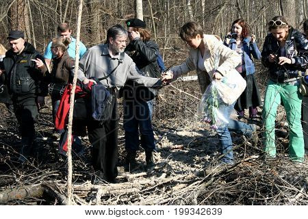 Khimki, Moscow region, Russia - April 23, 2011. Environmentalist Yevgenia Chirikova together with the defenders of Khimki forest goes to the place of cutting. Defenders of the Khimki forest opposes the felling of trees.