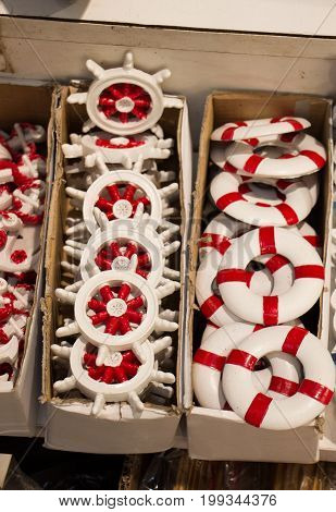 Set Of Decorative Life Preservers  And Steering Wheels