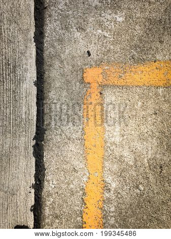 Close up of asphalt road with yellow marking