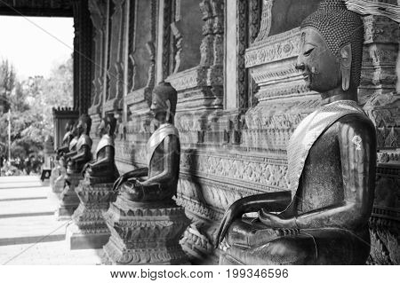Black and white picture of Buddha ,  Selective focus of first Buddha