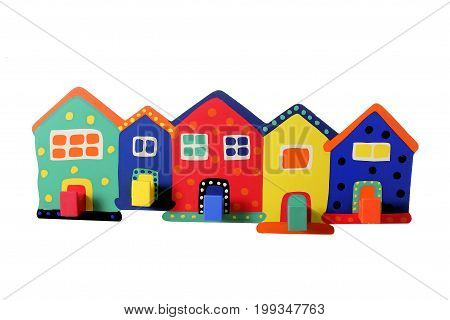 Toy Miniature Wooden Houses on White Background