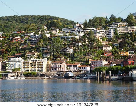 ASCONA travel city in SWITZERLAND with scenic view of beauty Lake Maggiore at canton of Ticino and slope of alpine mountain range landscape at swiss Alps in 2017 warm sunny summer day, Europe on July.