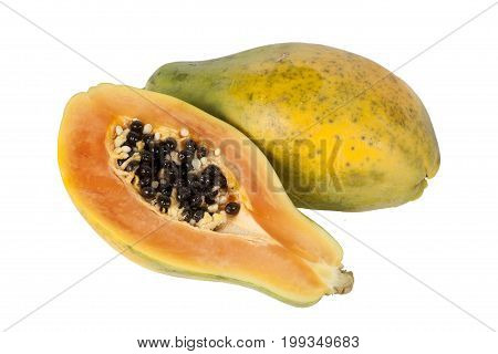 Papaya fruit halved cut out and isolated on a white background