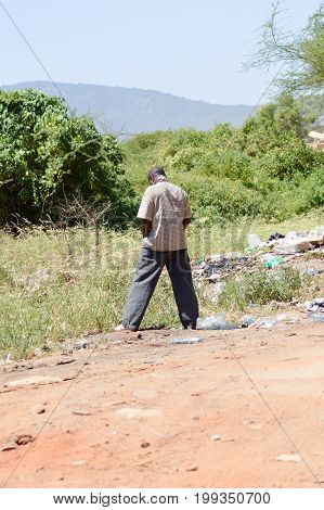 Young man on his way along the Mombasa road to Nairobi Kenya
