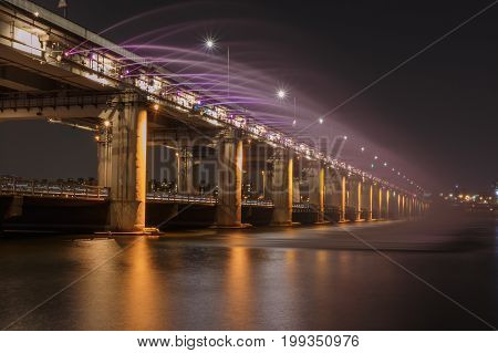 Banpo rainbow bridge fountain show taken during sunset hours Banpo bridge fountain show is situated on the Han River a major tourist attraction in Seoul South Korea.