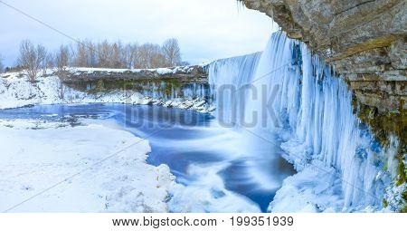 Winter ice covered and snowy waterfall, amazing site in Estonia