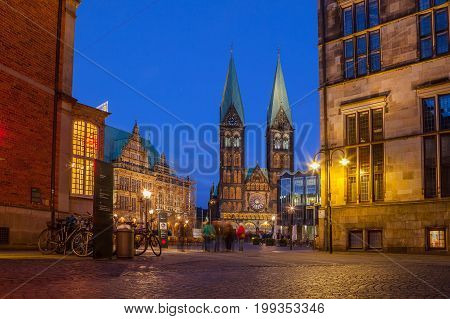 BREMEN, GERMANY - 16 APR 2016: City hall and St. Peter Cathedral on the market square. Everining view with illumination.