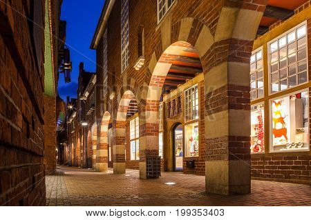 BREMEN, GERMANY - 16 APR 2016: Boettcherstreet by night in Bremen. Only about 100 m long, it is famous for its unusual architecture and ranks among the citys main cultural landmarks.