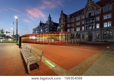 Central part of Katowice and the tram light trails in the evening. Poland