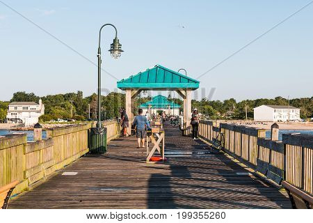 HAMPTON, VIRGINIA - JULY 9, 2017:  Fisherman on the Buckroe Beach fishing pier, located near a public park and beach.