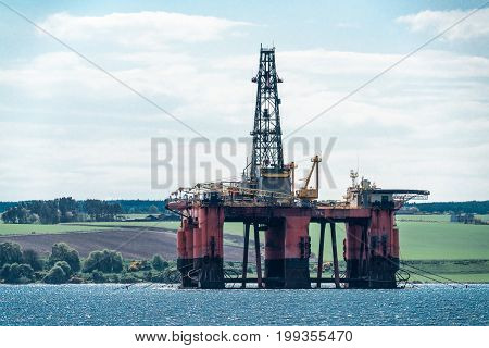Disused North Sea oil drilling rig moored in the Cromarty Firth Scotland